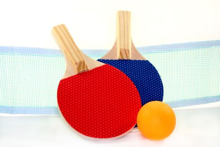 two table tennis bats, net and ball on a white\ background