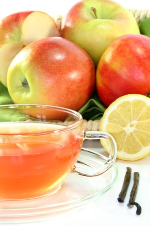 Apple Vanilla Lemon Tea with fresh apples, lemons and vanilla photo