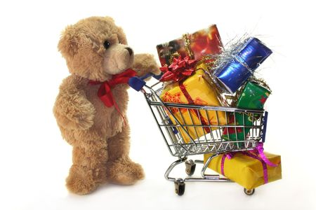 laden: Teddy with shopping cart, laden with colorful gifts Stock Photo
