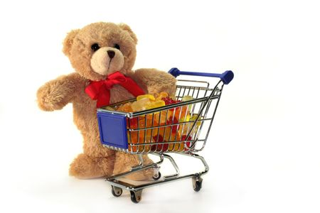 Teddy with shopping carts, laden with colorful gummy bears photo