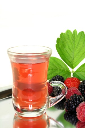 forest tea: a cup of tea forest fruit with fresh fruit