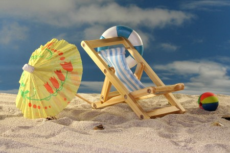 Deck chair and sun umbrella on a sandy beach Stock Photo - 7226873