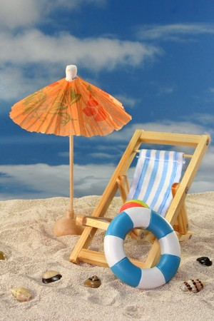 Deck chair and sun umbrella on a sandy beach Stock Photo - 7226821