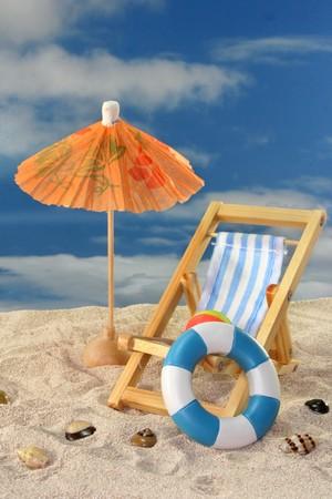 Deck chair and sun umbrella on a sandy beach Stock Photo - 7226821