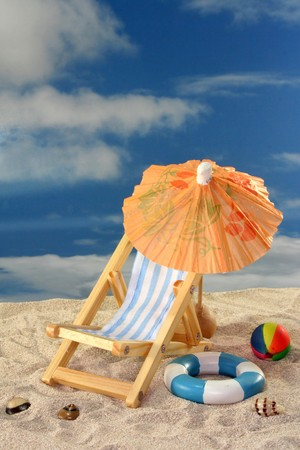 Deck chair and sun umbrella on a sandy beach Stock Photo - 7226874