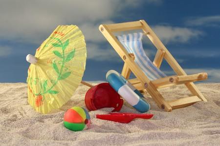 Deck chair and sun umbrella on a sandy beach Stock Photo - 7226887