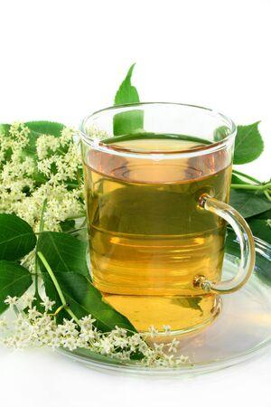 diuretic: a cup of Elderflower tea with fresh flowers