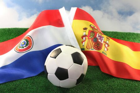 Country Flags and a football against a cloudy sky photo
