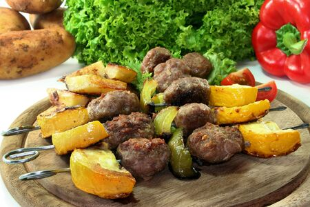 Grill skewers with meatballs, zucchini and bell pepper photo