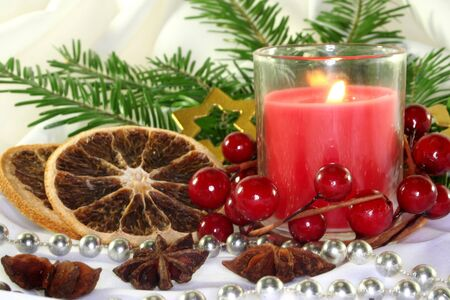 a burning candle with Christmas decorations Stock Photo - 7532494