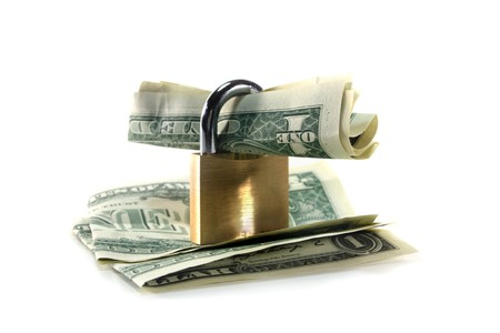 Padlock with dollar bills in front of white background photo