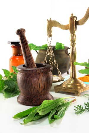 mortar and pestle: fresh herbs and spices on a white background Stock Photo