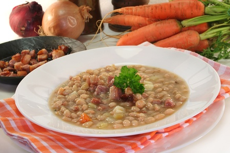 vegetable soup: white bean soup with roasted belly of pork Stock Photo