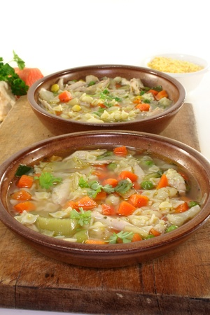 a chicken soup with shell pasta and vegetables photo