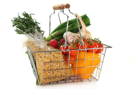 shopping basket: Shopping basket filled with various vegetables Stock Photo