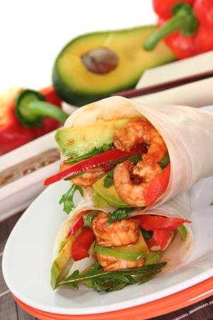 vietnamese: Wrap with shrimp, avocado and arugula  Stock Photo