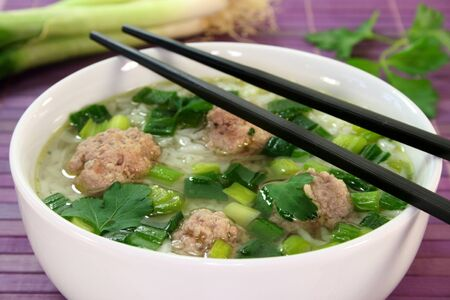 jasmine rice: Thai rice soup with meat balls and coriander Stock Photo