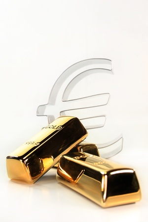Gold bars and Euro symbol on a white background Stock Photo - 8809149