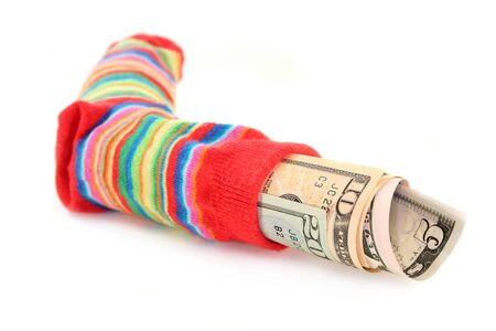 a colorful stockings, stuffed with dollar bills  photo