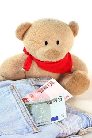 a teddy with two Euro notes and a pair of jeans  photo