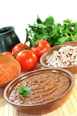 Indian dish with beans, lentils and tomato photo