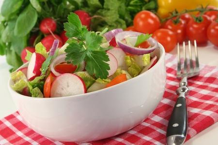 mixed salad with lettuce, tomato and radish photo