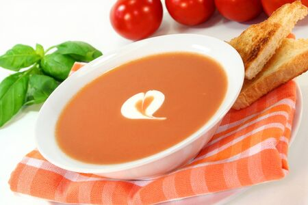 a bowl of tomato cream soup with toast photo