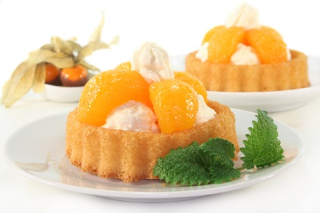 Mandarin cake with cream and lemon balm  Stock Photo
