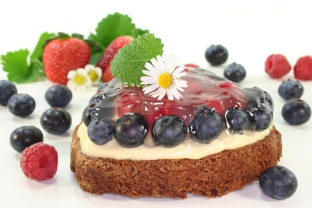 a forest fruit tarts with different berries