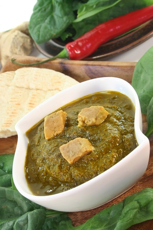 Indian Palak Paneer with rice and fresh ingredients  photo