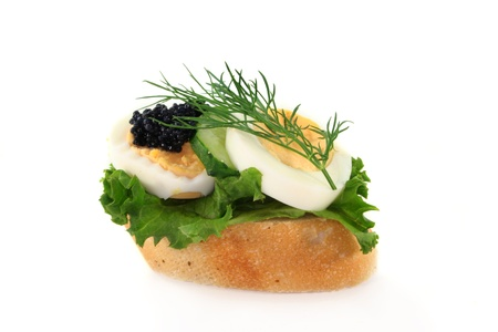 a baguette slice of boiled egg and caviar  photo