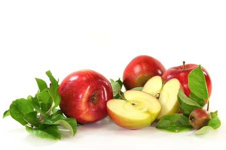 Apples and leaves on a white background Standard-Bild