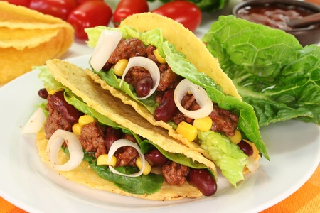 taco tortilla: Taco shells filled with ground beef, kidney beans and corn Stock Photo