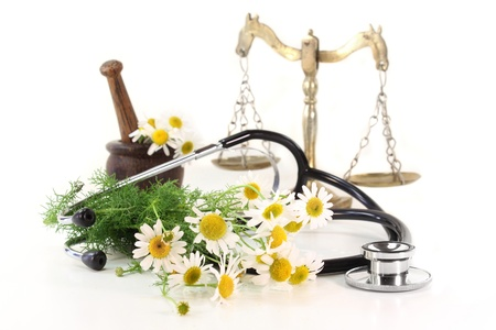 medicinal herb: Stethoscope on a white background and chamomile