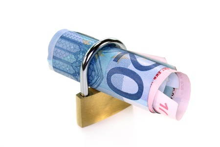fixed rate: Padlock and money roll on a white background  Stock Photo