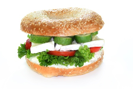 camembert: Bagel topped with a camembert cheese, cucumber and tomato  Stock Photo