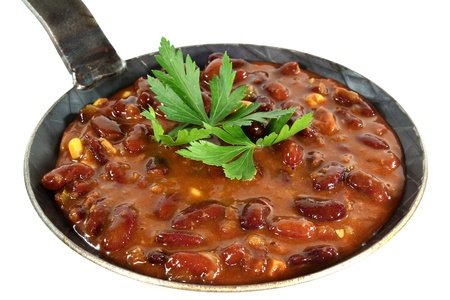 con: a pan with chilli con carne and parsley Stock Photo