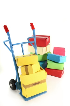 sack truck: a hand truck with various packages on a white background