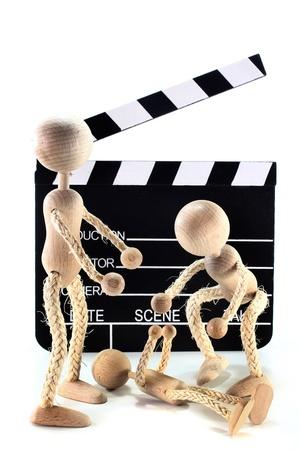 three wooden dolls to make a scene Stock Photo - 10877102