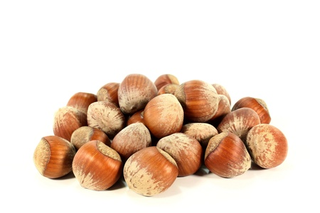 a handful of hazelnuts on a white background photo