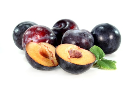 prunes: fresh plums on a white background