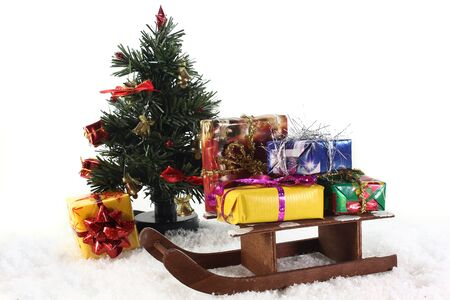 plushie: A slide with colorful gifts in the snow