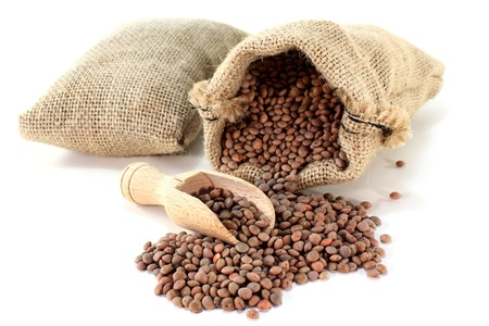 a sack of mountain lentils on a light background