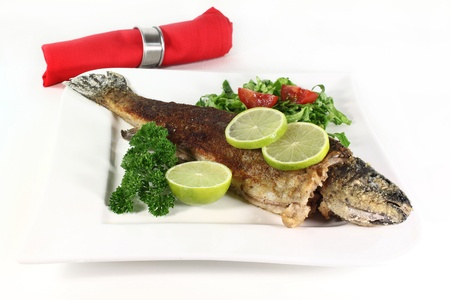 miller: roasted trout miller with parsley salad with Stock Photo