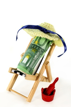 reclining chair: a reclining chair with a roll of euro bills  Stock Photo