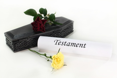 statutory: a small coffin with roses and Testament
