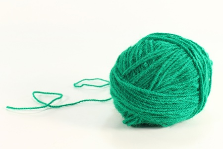 knitting needles: a green ball of yarn on a white background Stock Photo