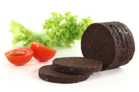 thaler: some slices of pumpernickel bread on a white background