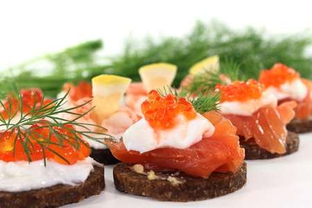 different canapes on a white background Stock Photo - 11791130
