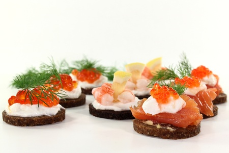 canapes: different canapes on a white background